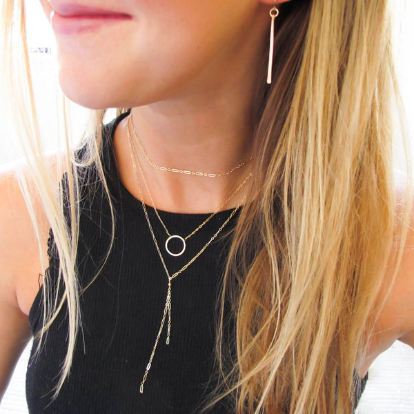 layered gold necklaces and earrings by delia langan jewelry