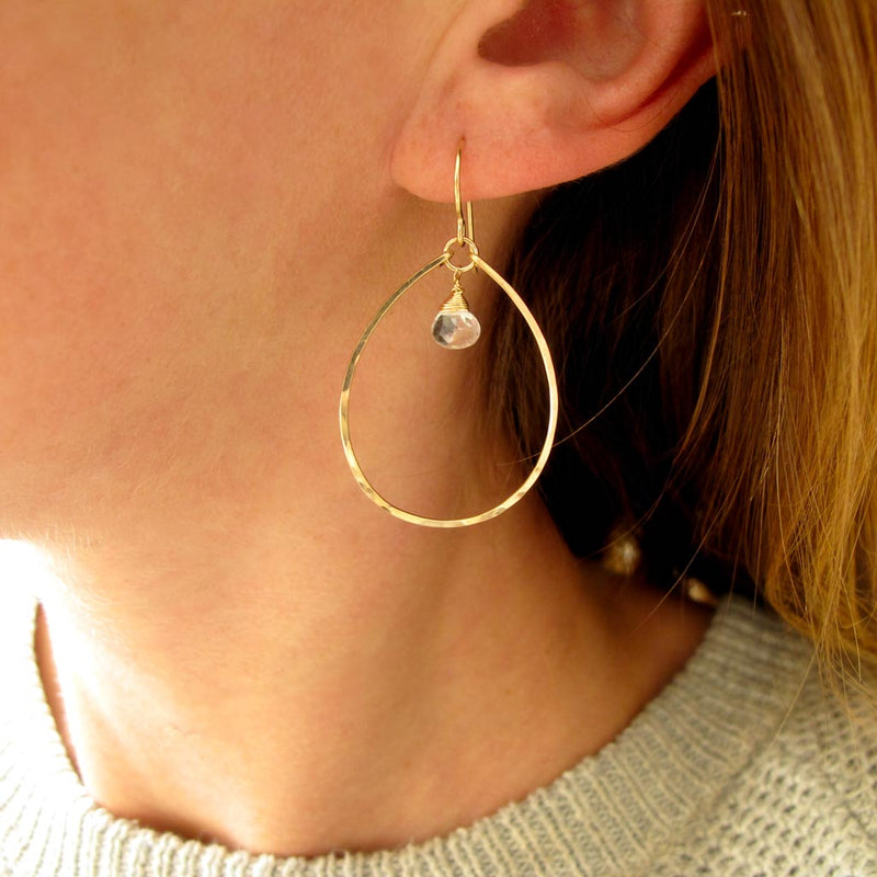 white topaz and thin gold oval hoop earrings