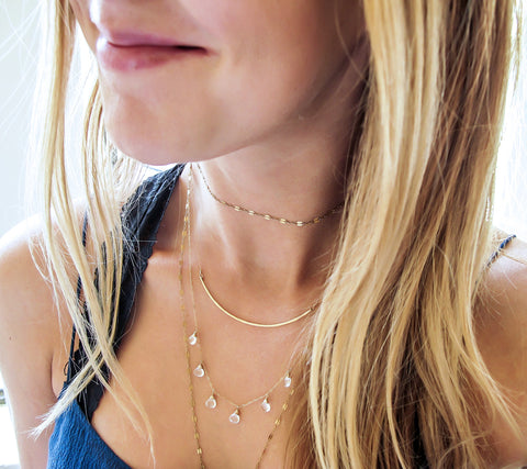 white topaz and gold layering necklaces by delia langan jewelry