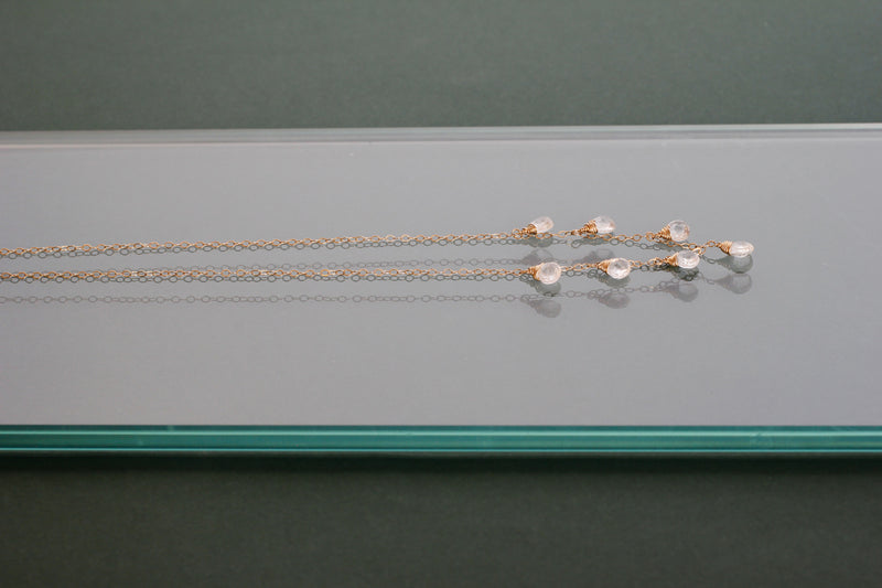 side view of white topaz and 14k gold filled necklace by delia langan jewelry