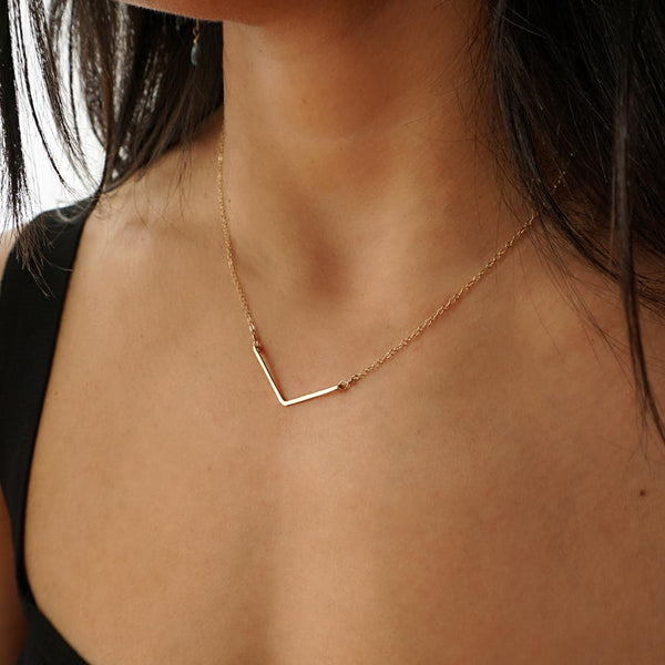 delicate gold v shaped pendant by tahastaffingsolutions