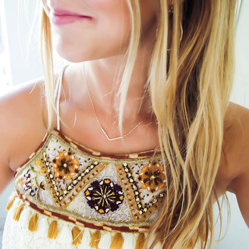 dainty gold v necklace delia langan jewelry