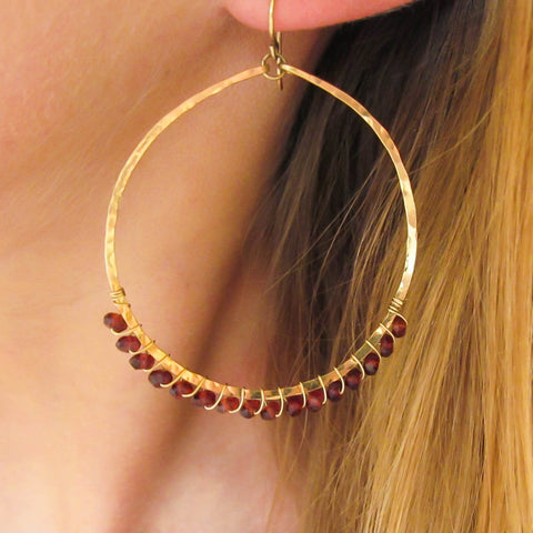 garnet and gold wire wrapped hammered hoop earrings by delia langan jewelry