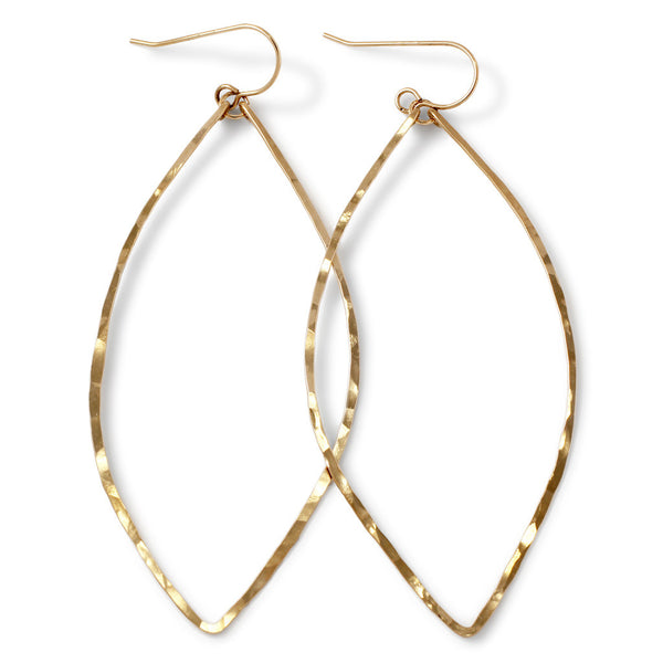 14k gold filled xl leaf hoop earrings on white surface