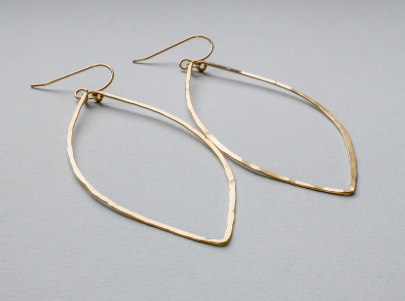 14k gold filled xl leaf hoop earrings on grey surface