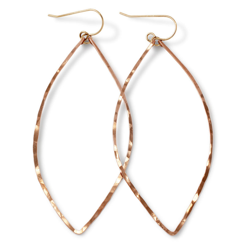 rose gold filled xl leaf hoop earrings on white surface