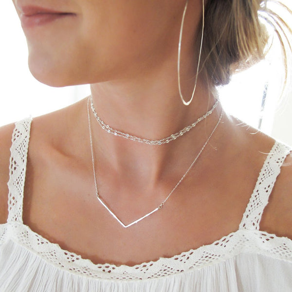 delicate sterling silver hammered chevron v shaped necklace layered with silver chain choker necklace handmade by delia langan jewelry