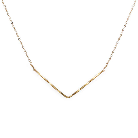 delicate gold hammered chevron v shaped necklace handmade by delia langan jewelry