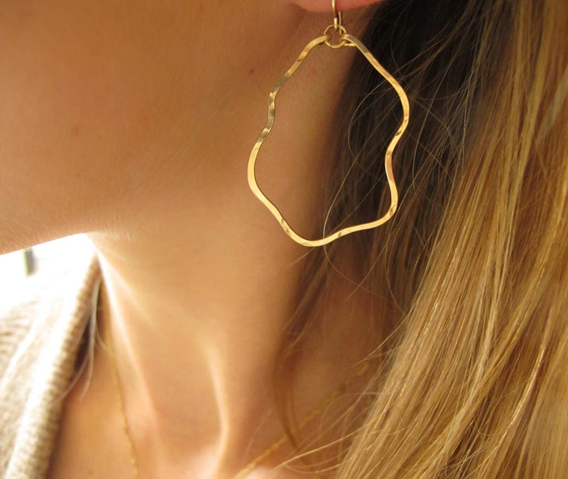 blond woman ear closeup wearing 14k gold filled yung spud hoop earrings