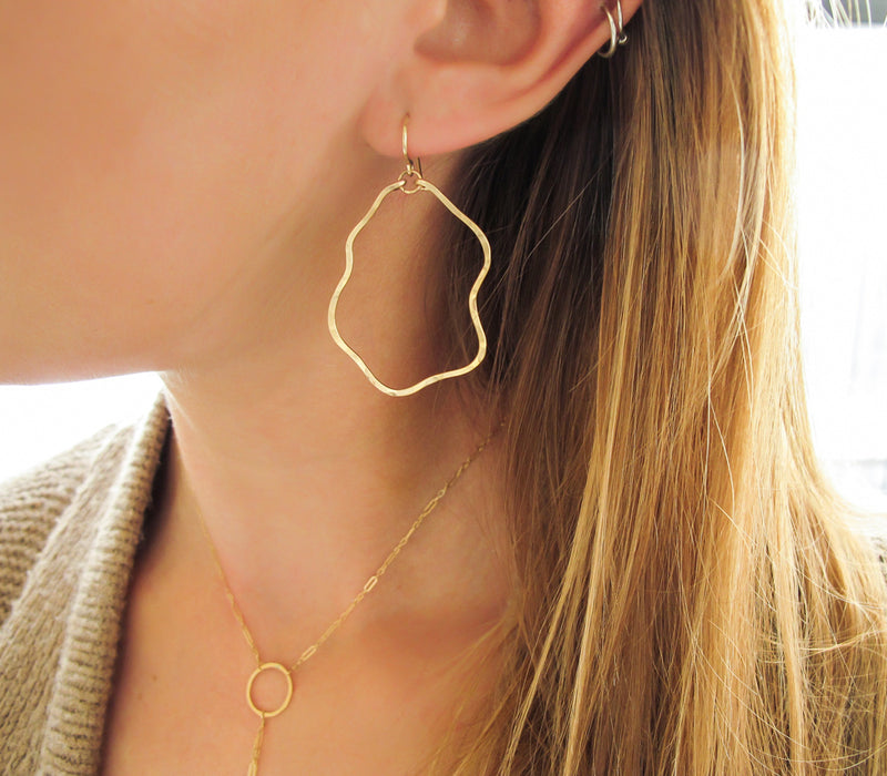 wavy thin hammered organic shaped gold hoop earrings