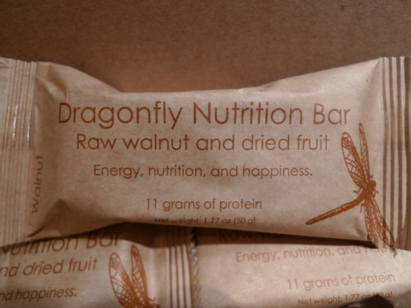 Walnut, organic coconut, and organic dried fruit nutrition bar