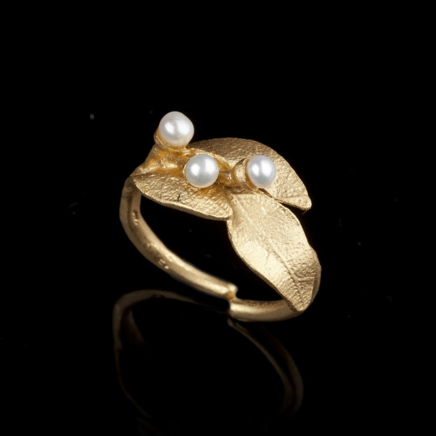 The Bay Laurel ring is cast in bronze with 24kt. gold plate and accented with white freshwater pearls.