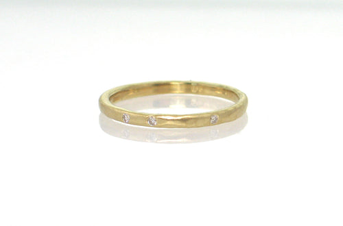 18k yellow gold 2mm round band hammered, matte finish, style R480, 3 diamonds, size 7. Stephany Hitchcock Designs, www.StephanyHitchcock.com