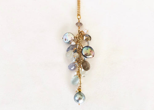 necklace with grey pearls, aquamarines, moonstones, blue sapphires, clear sapphires, Labradorite, clear topaz and small pearls. 14K