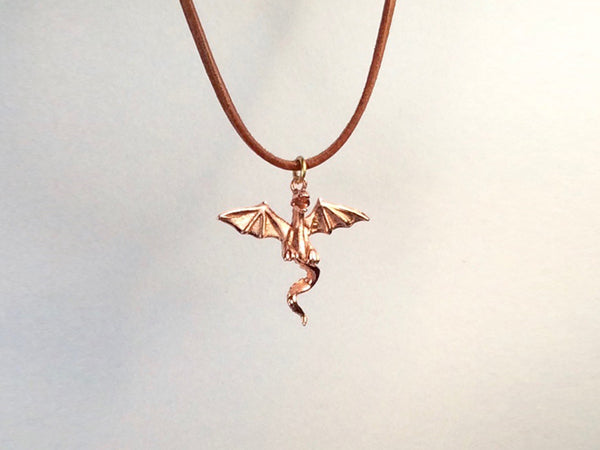 Flying Dragon necklace on  leather cord, Dragon necklace, golden bronze dragon necklace