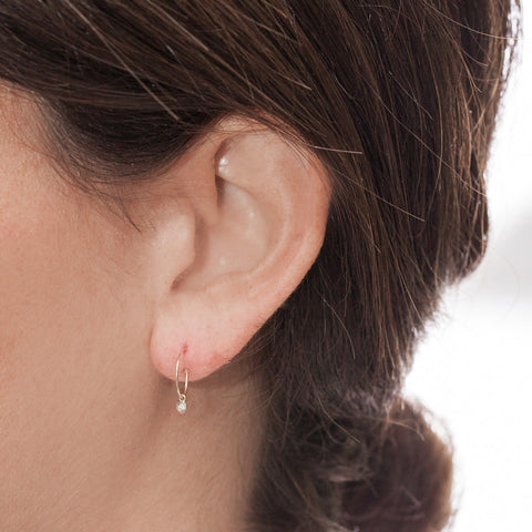Tiny Bezel Diamond Hook Earrings on model