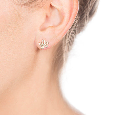 Gold Flower Diamond Studs on Person