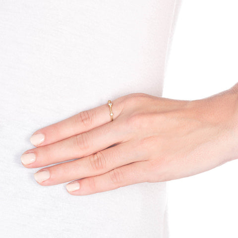 Supernova Gold Ring with Diamonds on model
