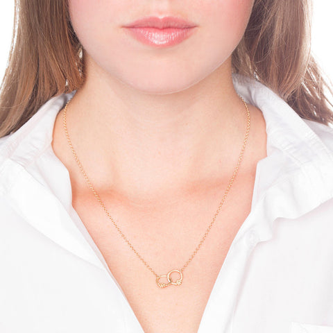 Interlocking Gold Necklace with Diamonds on Person