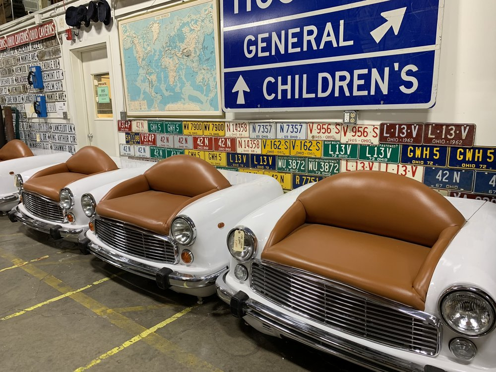 Chairs made out of car fronts