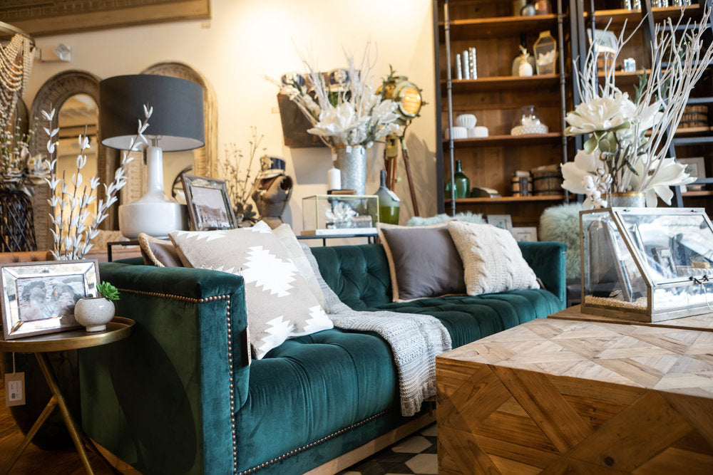 Teal couch with neutral design pillows