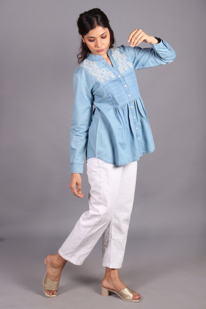 White embroidered peplum gathered denim top