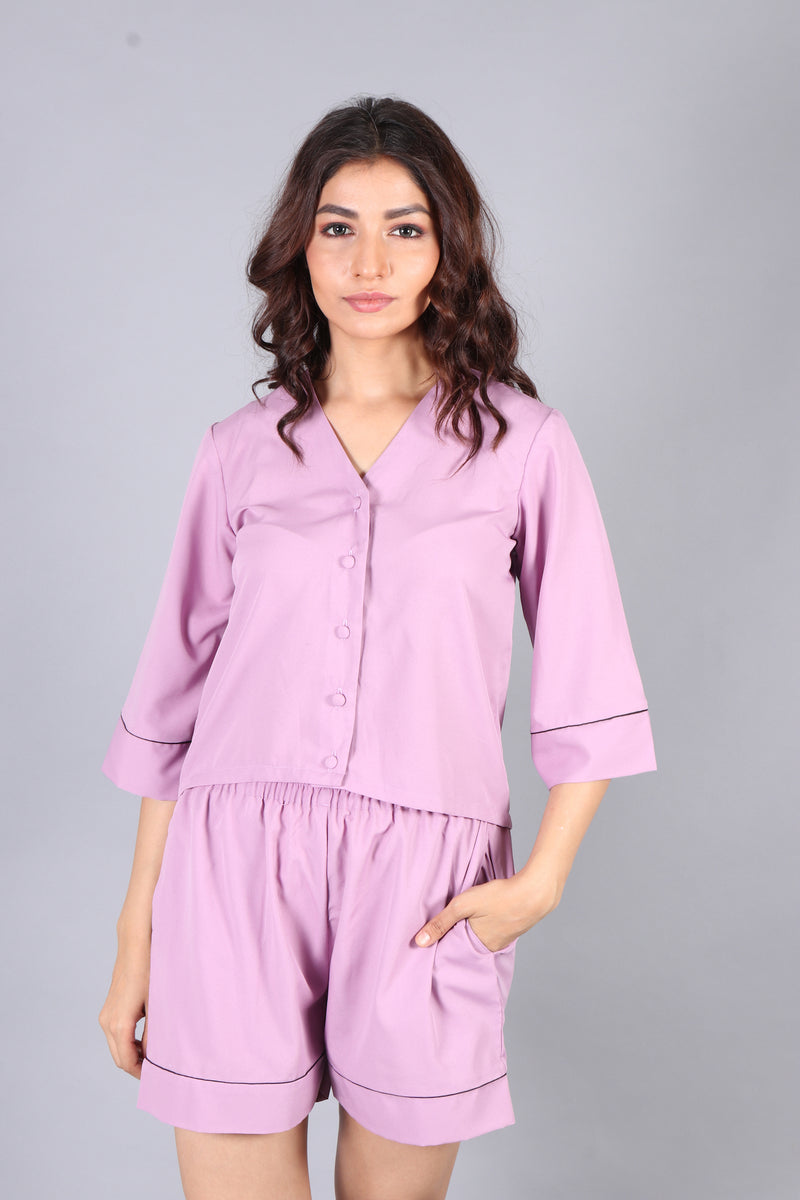 Loose fit lavender shorts with front button top