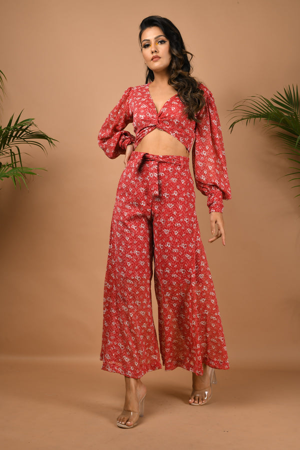 Dobby red self textured flarred pants with front knot crop top
