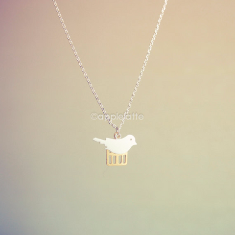 A Bird With Cage Necklace