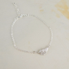 tiny feather bracelet