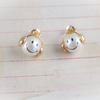 happy headset smile pearl earrings
