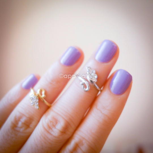 angel knuckle ring