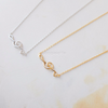 Sideways Treble Clef Necklace