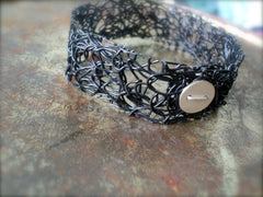 Silver and Flexible Plastic Mesh Contemporary Bracelet