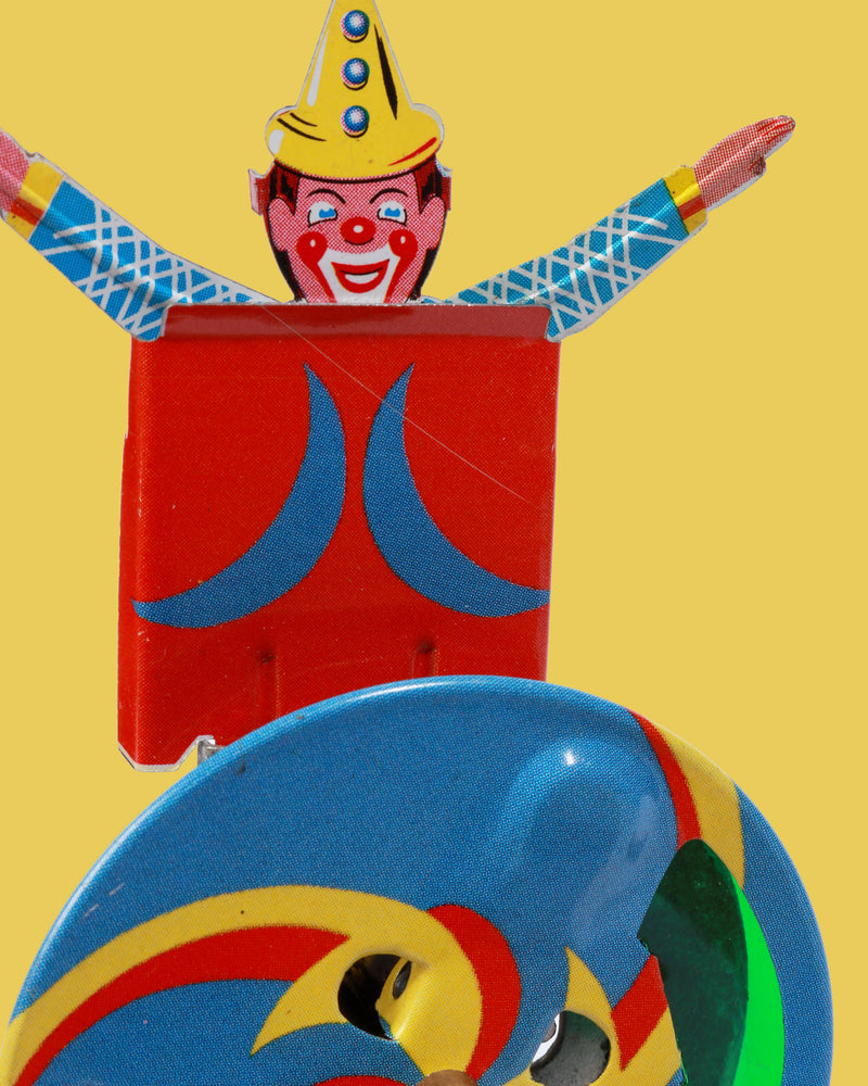Sparkle Clown Tin Toy