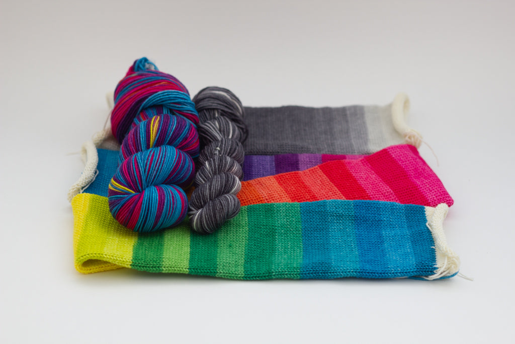 Knitted rainbow yarn from Gauge Dye Works
