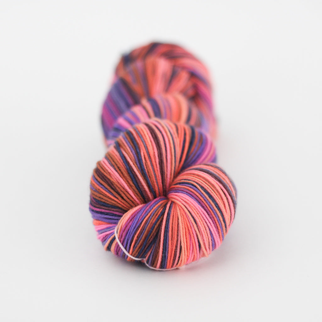 Azurite D orange and purple self striping classic sock yarn from gauge dye works