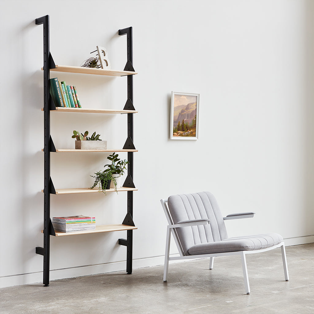 black uprights black brackets blonde shelves