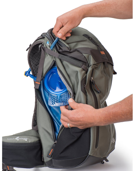 Dedicated zippered hydration compartment on side fits most 2L reservoirs or 32 oz water bottles