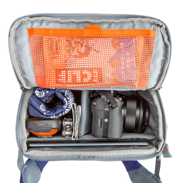 Rotating beltpack for accessing photographer essentials
