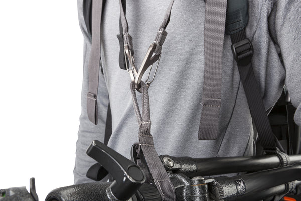 "Adjustment straps let you photograph while ""tethered"" to the tripod"