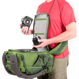 Adjustable neck strap keeps the back panel against your chest providing unencumbered access to your gear