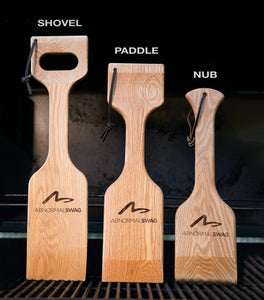 "Image of wood Great Scrape BBQ cleaning tools in Nub (16""), Paddle (18""), and Shovel (20"") sizes"