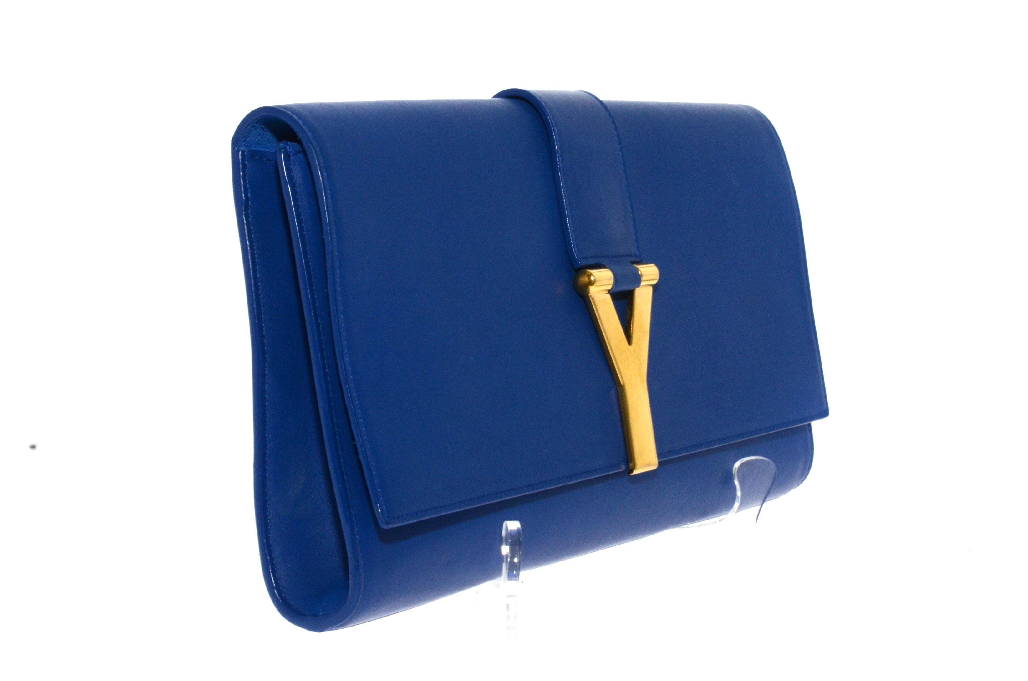 12c9bbf634d Yves Saint Laurent Royal Blue Leather Clutch. – The Vintage Contessa ...