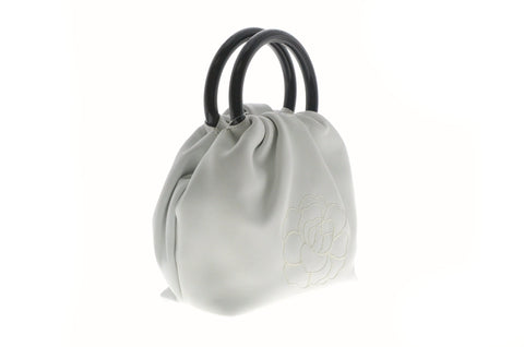 Chanel White Camilla Evening Bag with Black Handles.