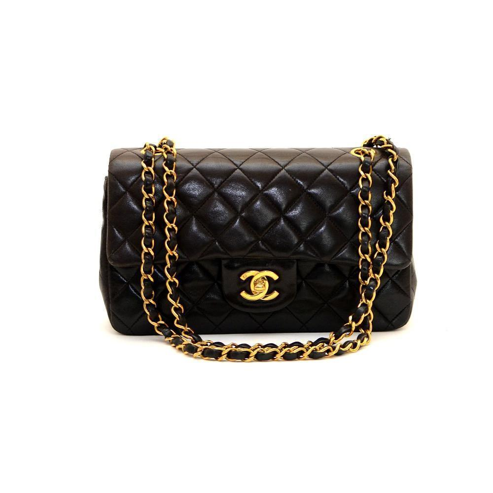 8fd34fd620ac Authentic Vintage Chanel 23cm Bag in Black Calf Leather with Gold Hardware