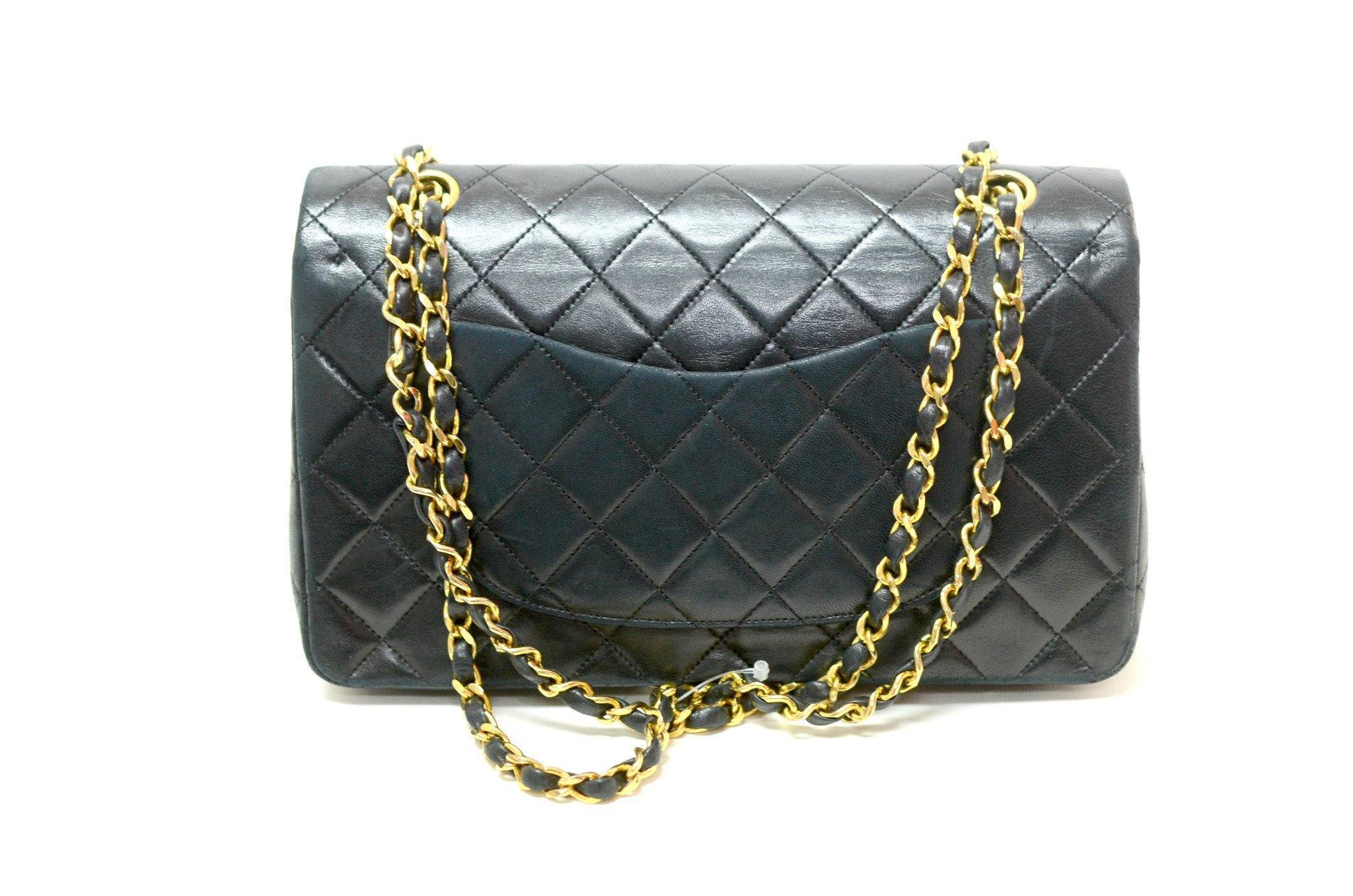 150800930d88 Authentic Vintage Chanel 25cm Bag in Black Calf Leather with Gold Hardware