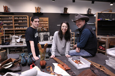 The team of Ethos Custom Brands smiling while working in the shop in Fort Smith, Arkansas.
