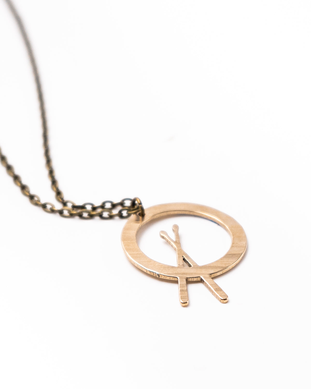 Cross Stick - Reclaimed Cymbal Necklace