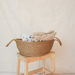 Natural jute basket with blanket inside
